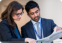 Two business professionals looking at a document