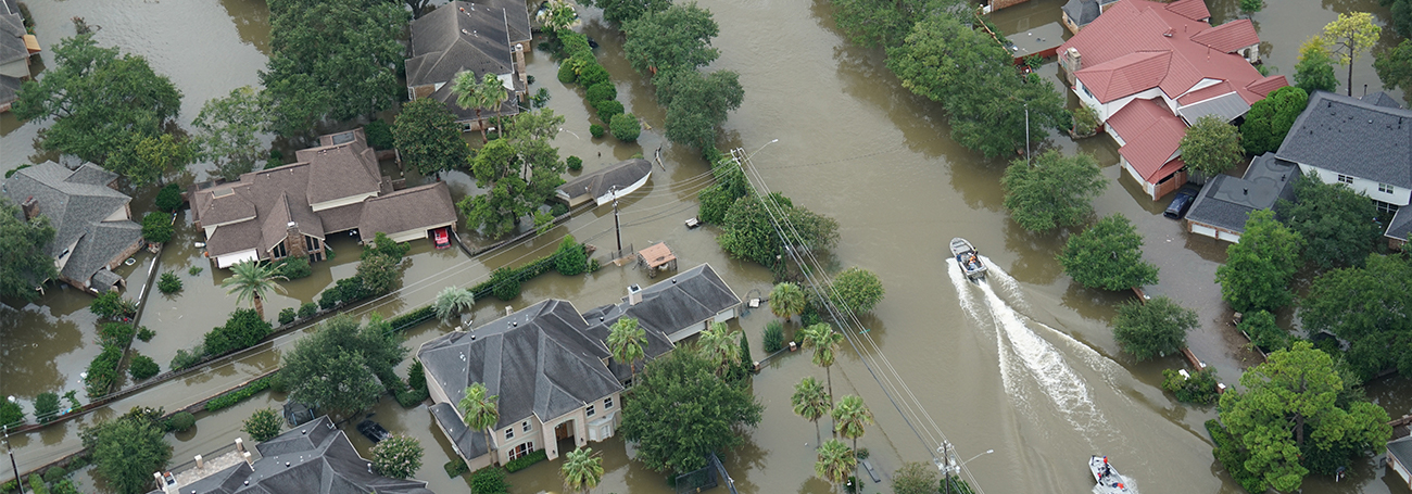 Aerial shot of a neighborhood flooded by a natural disaster