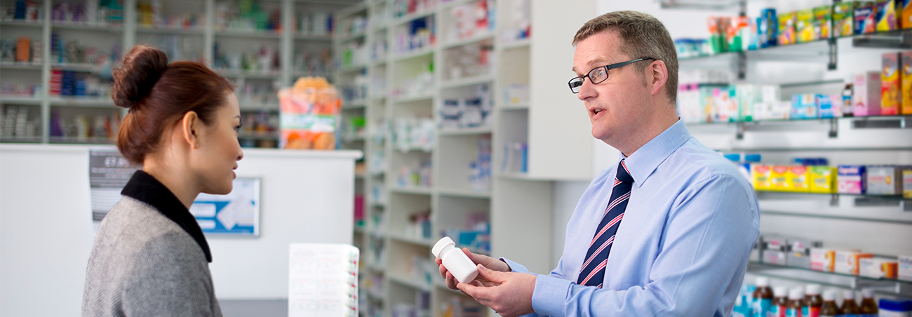 Pharmacist consulting a customer